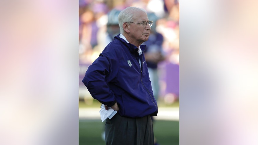 Kansas State coach Bill Snyder watches his team before a NCAA college football game against the Stephen F. Austin Saturday, Aug. 30, 2014, in Manhattan, Kan. (AP Photo/Charlie Riedel)