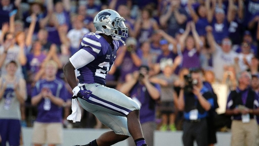 Kansas State running back Charles Jones celebrates in the end zone after scoring a touchdown during the first half of an NCAA college football game against Stephen F. Austin Saturday, Aug. 30, 2014, in Manhattan, Kan. (AP Photo/Charlie Riedel)