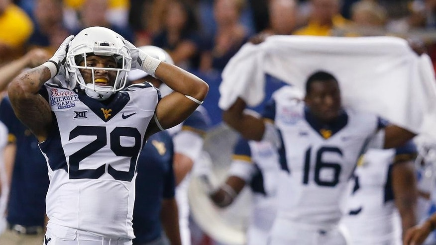 West Virginia running back Dustin Garrison (29) reacts after an incomplete pass in the second half of an NCAA college football game against Alabama on Saturday, Aug. 30, 2014, in Atlanta. Alabama won 33-23. (AP Photo/Brynn Anderson)
