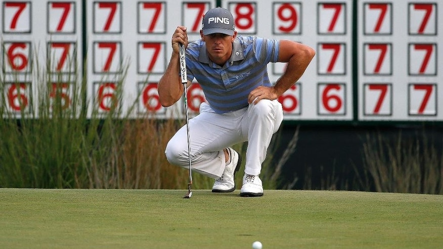 Billy Horschel lines up a putt on the 18th hole during the third round of the Deutsche Bank Championship golf tournament in Norton, Mass., Sunday, Aug. 31, 2014. (AP Photo/Michael Dwyer)