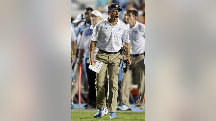North Carolina coach Larry Fedora yells during the second half of an NCAA college football game against Liberty in Chapel Hill, N.C., Saturday, Aug. 30, 2014. North Carolina won 56-29. (AP Photo/Gerry Broome)