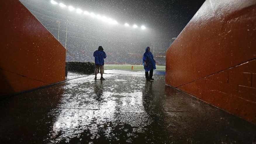 Rain pours down on the field at Ben Hill Griffin stadium as a weather delay continues to hold up the start of an NCAA college football game between Florida and Idaho in Gainesville, Fla., Saturday, Aug. 30, 2014. (AP Photo/John Raoux)