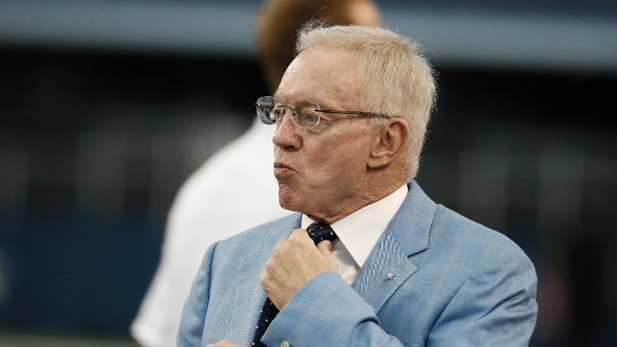 "FILE - In this Aug. 28, 2014, file photo, Dallas Cowboys owner Jerry Jones looks on before an NFL preseason football game against the Denver Broncos in Arlington, Texas. The usually optimistic Jerry Jones is using ""uphill climb"" rather than ""Super Bowl"" to describe the outlook of his Cowboys.  (AP Photo/Brandon Wade, File)"