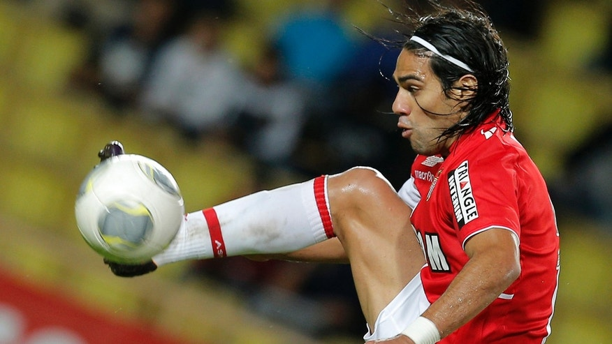 Radamel Falcao of Colombia as he controls the ball during his French League One soccer match against Evian, in Monaco stadium.   Radamel Falcao is set to join Manchester United on loan after the Premier League club agreed to a loan deal with Monaco, a person with knowledge of the deal said Monday Sept. 1, 2014. (AP Photo/Lionel Cironneau, File)