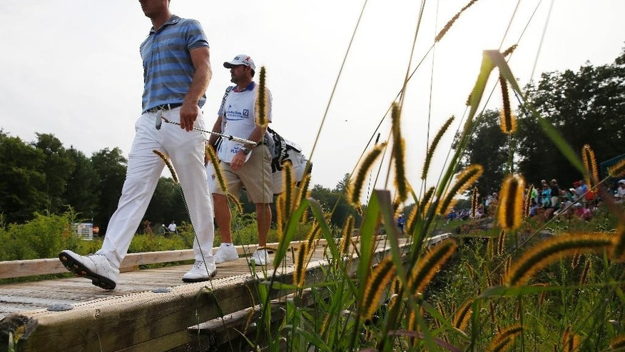 Billy Horschel, left, walks onto the 18th green during the third round of the Deutsche Bank Championship golf tournament in Norton, Mass., Sunday, Aug. 31, 2014. (AP Photo/Michael Dwyer)
