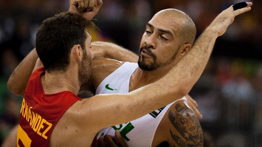 Brazil's Marcus Vieira, right, fights for a position on the court with Spain's Rudy Fernandez during the Group A Basketball World Cup match between Brazil and Spain in Granada, Spain, Monday Sept. 1, 2014. The 2014 Basketball World Cup competition will take place in various cities in Spain from Aug. 30 through to Sept. 14. (AP Photo/Daniel Tejedor)