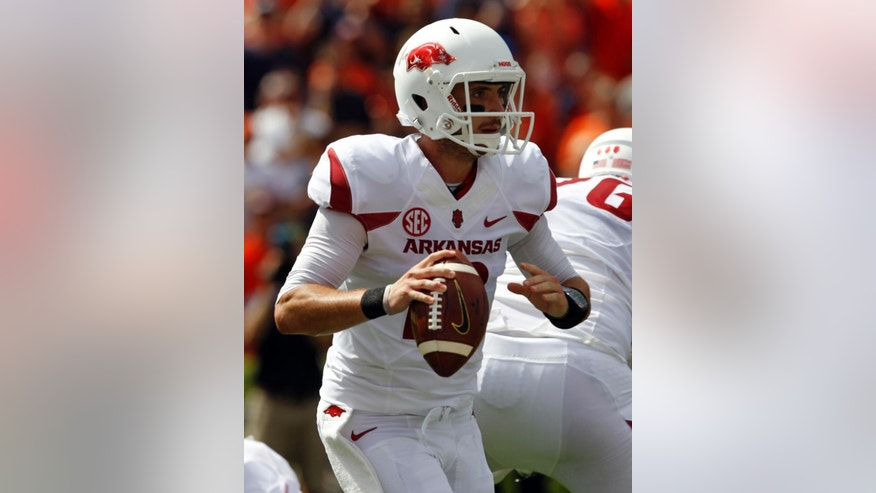 Arkansas quarterback Brandon Allen (10) looks to throw against Auburn during the first half of an NCAA college football game on Saturday, Aug. 30, 2014, in Auburn, Ala. (AP Photo/Butch Dill)