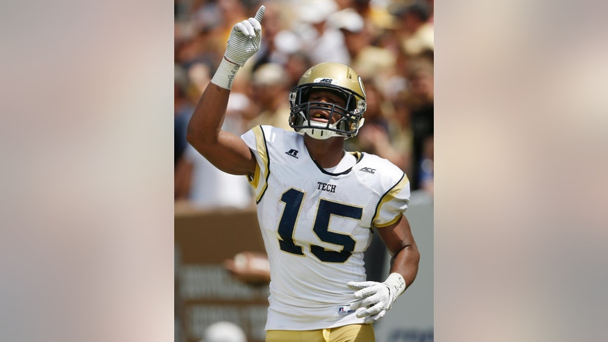 Georgia Tech wide receiver DeAndre Smelter (15) celebrates his touchdown against Wofford during the second half of an NCAA college football game, Saturday, Aug. 30, 2014, in Atlanta. Georgia Tech won 38-19.(AP Photo/Mike Stewart)