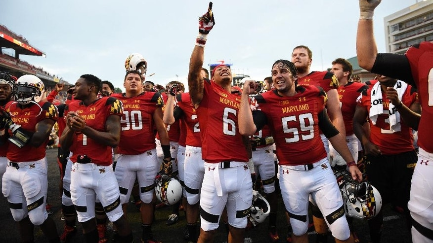 Maryland wide receiver Deon Long (6), Christian Carpenter (59) and others celebrate with fans after they defeated James Madison 52-7 in an NCAA college football game, Saturday, Aug. 30, 2014, in College Park, Md. (AP Photo/Nick Wass)