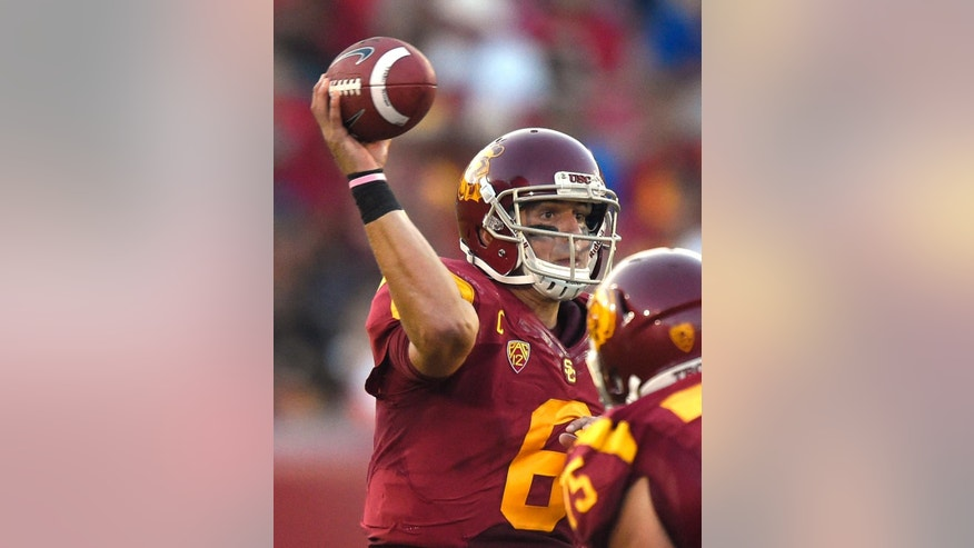 Southern California quarterback Cody Kessler passes during the second half of an NCAA college football game against Fresno State, Saturday, Aug. 30, 2014, in Los Angeles.  USC won 52-13. (AP Photo/Mark J. Terrill)