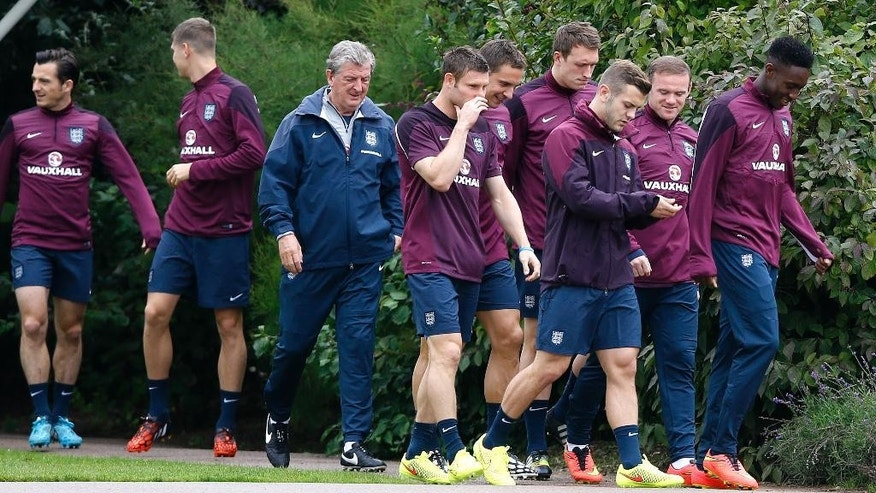 England's soccer team manager Roy Hodgson and his players arrive for a training session at London Colney, Monday, Sept. 1, 2014. England will play Norway in an international friendly soccer match at Wembley Stadium on Wednesday. (AP Photo/Kirsty Wigglesworth)