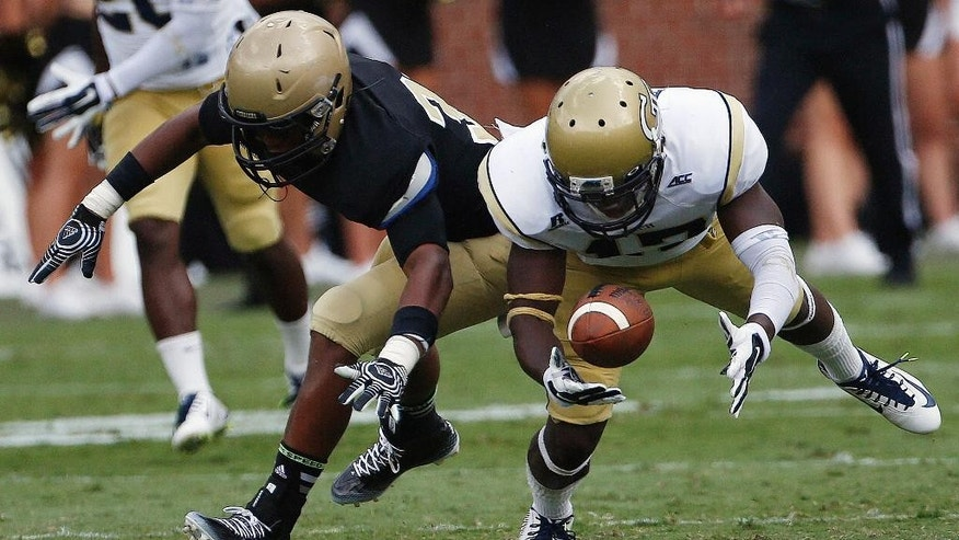 Georgia Tech defensive back Lance Austin (17) breaks up a pass intended for Wofford running back Octavius Harden (33) during the second half of an NCAA college football game, Saturday, Aug. 30, 2014, in Atlanta. Georgia Tech won 38-19. (AP Photo/Mike Stewart)