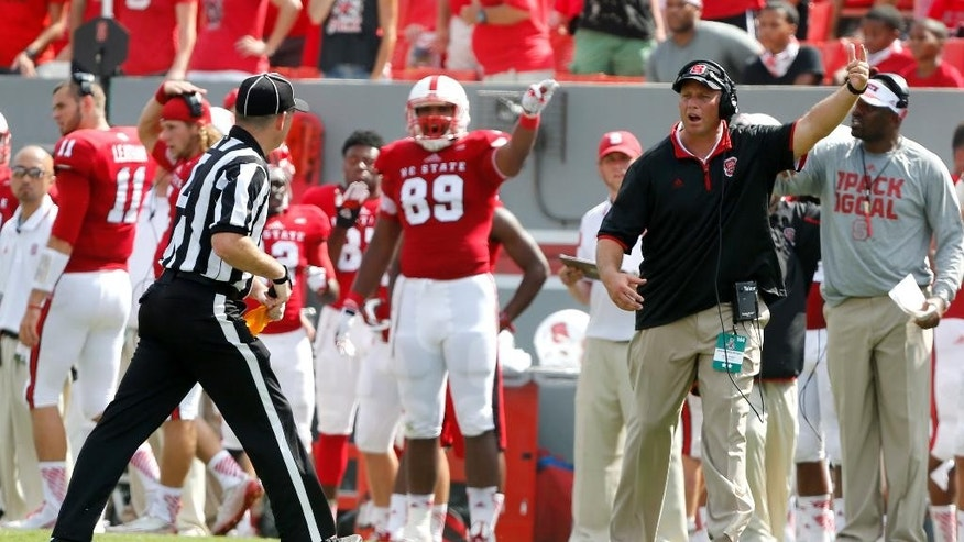 North Carolina State head coach Dave Doeren motions to the officials during the second half of an NCAA college football game against Georgia Southern, Saturday, Aug. 30, 2014, in Raleigh, N.C. N.C. State won 24-23. (AP Photo/The News & Observer, Ethan Hyman)