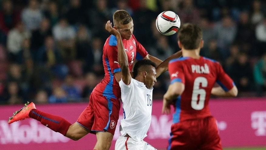 Czech Republic's Vaclav Pilar, right, looks on as his teammate Pavel Kaderabek, left, challenges Julian Green of the U..S, center, during their friendly soccer match in Prague, Czech Republic, Wednesday, Sept. 3, 2014.  (AP Photo/Petr David Josek)