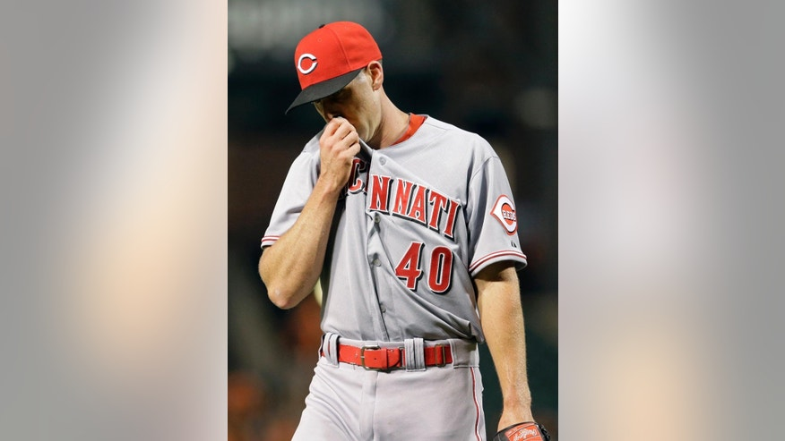 Cincinnati Reds starting pitcher Dylan Axelrod walks off the field after the third inning of an interleague baseball game against the Baltimore Orioles, Wednesday, Sept. 3, 2014, in Baltimore. (AP Photo/Patrick Semansky)