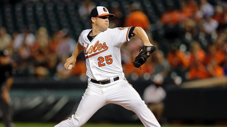 Baltimore Orioles starting pitcher Bud Norris throws to the Cincinnati Reds in the first inning of an interleague baseball game, Tuesday, Sept. 2, 2014, in Baltimore. (AP Photo/Patrick Semansky)