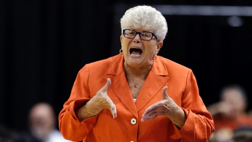 Indiana Fever coach Lin Dunn yells to her team as the Fever played the Chicago Sky in the first half of Game 3 of the WNBA Eastern Conference basketball finals in Indianapolis, Wednesday, Sept. 3, 2014. (AP Photo/Michael Conroy)