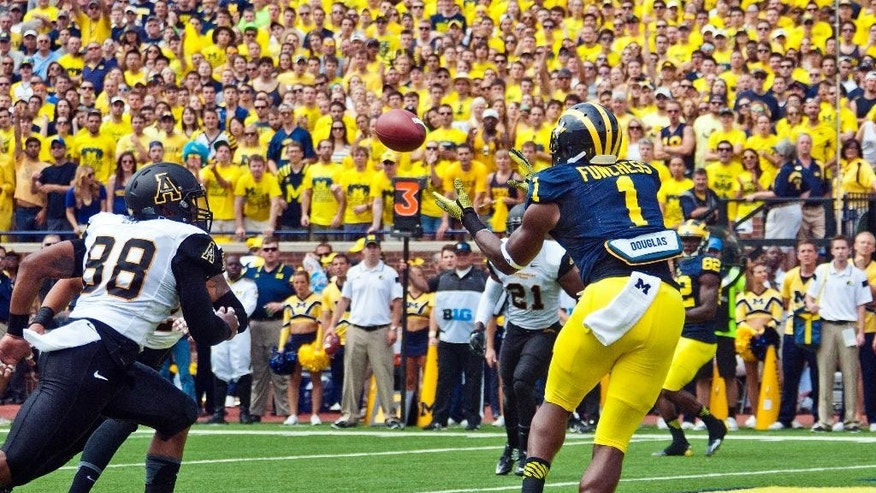 Michigan wide receiver Devin Funchess (1) makes a reception for a touchdown in the first quarter of an NCAA college football game against Appalachian State in Ann Arbor, Mich., Saturday, Aug. 30, 2014. (AP Photo/Tony Ding)
