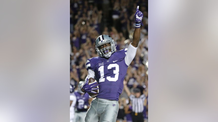 Kansas State wide receiver Steven West (13) celebrates after scoring a touchdown during the second half of an NCAA college football game against Stephen F. Austin Saturday, Aug. 30, 2014, in Manhattan, Kan. (AP Photo/Charlie Riedel)