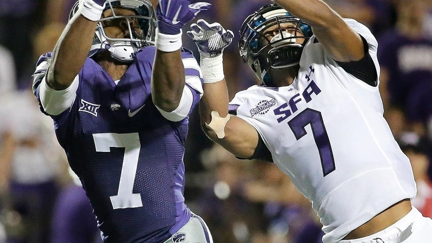 Stephen F. Austin defensive back Hipolito Coporan, right, breaks up a pass intended for Kansas State wide receiver Judah Jones, left, during the second half of an NCAA college football game Saturday, Aug. 30, 2014, in Manhattan, Kan. (AP Photo/Charlie Riedel)