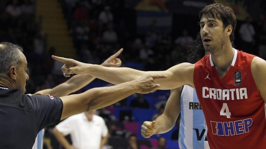 Croatia's Ante Tomic, right, gestures during the Group B Basketball World Cup match between Argentina and Croatia in Seville, Spain, Sunday, Aug. 31, 2014. The 2014 Basketball World Cup competition will take place in various cities in Spain from Aug. 30 through to Sept. 14. (AP Photo/Miguel Angel Morenatti)