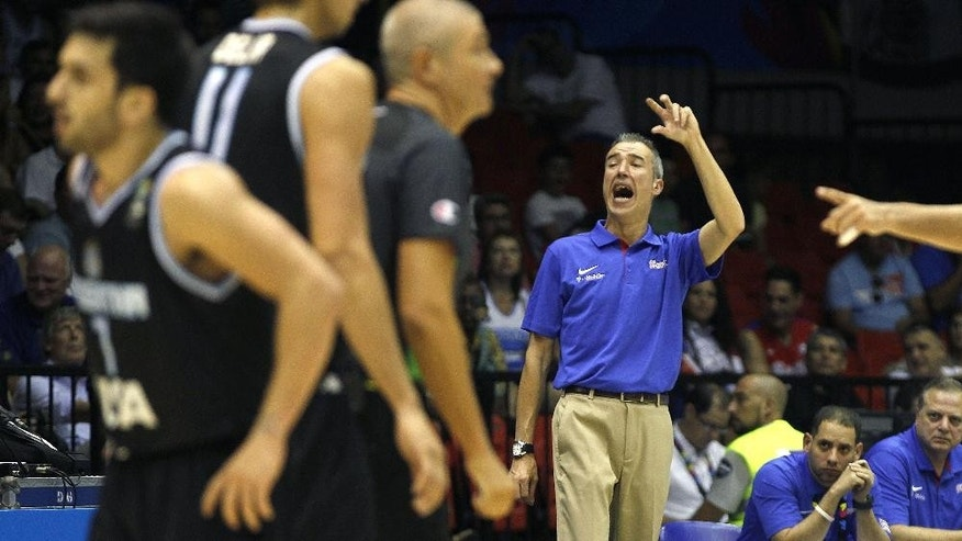 Puerto Rico's coach Paco Olmos gestures during the Group B Basketball World Cup match between Argentina and Puerto Rico in Seville, Spain, Saturday, Aug. 30, 2014. The 2014 Basketball World Cup competition will take place in various cities in Spain from Aug. 30 through to Sept. 14. (AP Photo/Miguel Angel Morenatti)