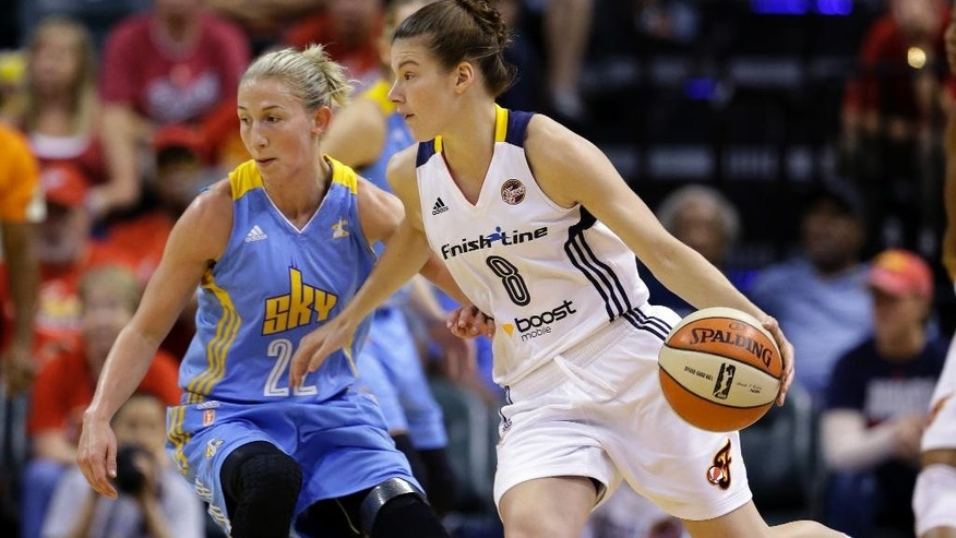 Indiana Fever guard Maggie Lucas, right, drives on Chicago Sky guard Courtney Vandersloot in the first half of Game 3 of the WNBA Eastern Conference basketball finals in Indianapolis, Wednesday, Sept. 3, 2014. (AP Photo/Michael Conroy)