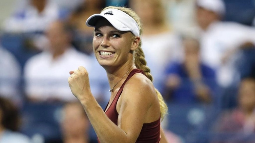 Caroline Wozniacki, of Denmark, clenches her fist after defeating Sara Errani, of Italy, 6-0, 6-1 during the quarterfinals the U.S. Open tennis tournament, Tuesday, Sept. 2, 2014, in New York. (AP Photo/Charles Krupa)