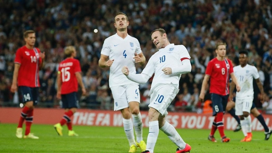 England's Wayne Rooney celebrates after scoring the opening goal during the international friendly soccer match between England and Norway at Wembley Stadium in London, Wednesday, Sept. 3, 2014. (AP Photo/Alastair Grant)