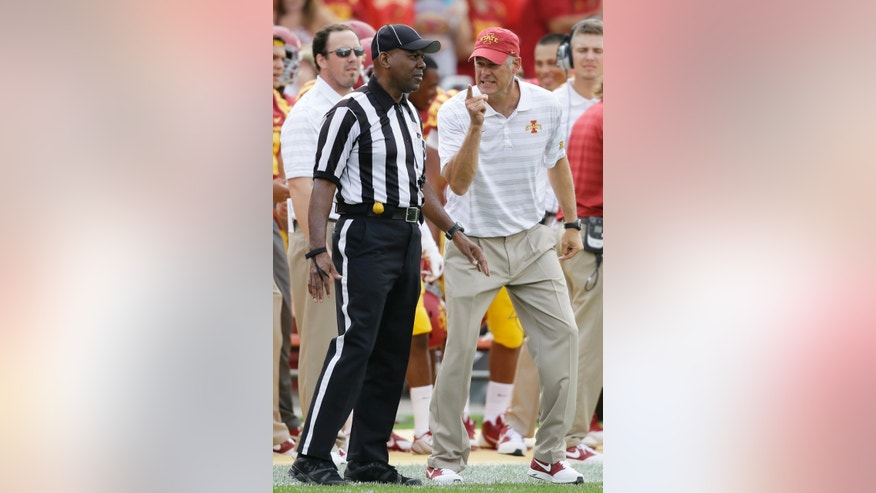 Iowa State head coach Paul Rhoads, right, reacts to a call against his team during the first half of an NCAA college football game against the North Dakota State, Saturday, Aug. 30, 2014, in Ames, Iowa. (AP Photo/Charlie Neibergall)