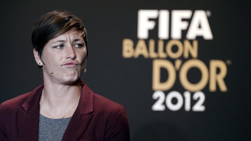 FILE - In this Jan. 7, 2013, file photo, USA's Abby Wambach speaks at a press conference during the FIFA Ballon d'Or Gala 2013 held at the Kongresshaus in Zurich, Switzerland. The law firm that represents soccer players who object to an artificial turf surface at the Women's World Cup says a FIFA-commissioned survey of players shows that 77 percent feel major tournaments should be played on natural grass. But that wasn't enough to sway organizers to let the women play on grass. Wambach, a group of teammates and a number of international players are protesting the artificial surface, claiming that forcing the women to play on turf amounts to gender discrimination. (AP Photo/Keystone/Walter Bieri, File)
