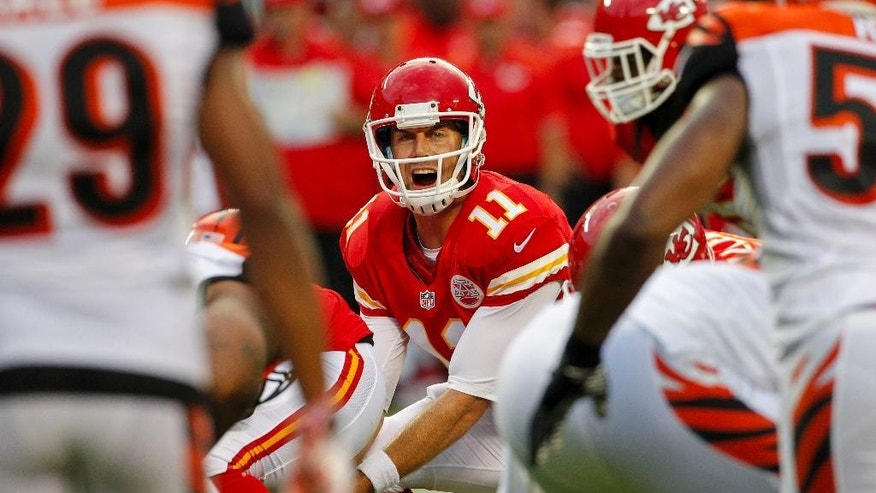 FILE - In this Aug. 7, 2014, file photo, Kansas City Chiefs quarterback Alex Smith (11) calls a play in the first half of an NFL preseason football game against the Cincinnati Bengals in Kansas City, Mo. Smith signed a $68 million extension Sunday, Aug. 31, 2014, to remain with the Chiefs through the 2018 season, a person familiar with the deal told The Associated Press. The person spoke on condition of anonymity because the team did not disclose the terms of the contract. (AP Photo/Colin E. Braley, File)