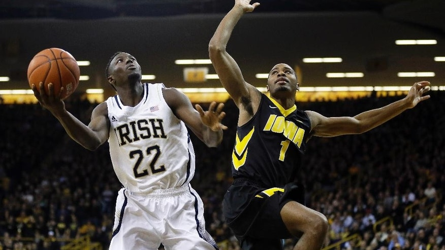FILE - In this Dec. 3, 2013, file photo, Notre Dame guard Jerian Grant, left, drives to the basket ahead of Iowa forward Melsahn Basabe during the first half of an NCAA college basketball game in Iowa City, Iowa. Grant, the leading scorer for Notre Dame's basketball team when he was suspended in December, is expected to meet with the media Thursday, Sept. 4, 2014, to  discusses what he said then was an academic matter he didn't handle properly. (AP Photo/Charlie Neibergall, File)