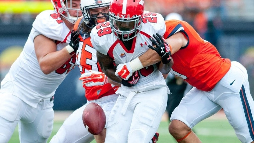 Youngstown State running back Martin Ruiz (29) has the ball knocked loose by Illinois defensive back Taylor Barton (3) during the first quarter of an NCAA college football game, Saturday, Aug. 30, 2014 at Memorial Stadium in Champaign, Ill. (AP Photo/Bradley Leeb)