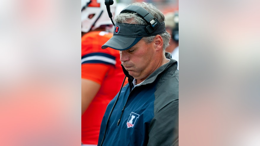 Illinois head coach Tim Beckman reacts on the sideline during the third quarter of an NCAA college football game against Youngstown State, Saturday, Aug. 30, 2014 at Memorial Stadium in Champaign, Ill. (AP Photo/Bradley Leeb)