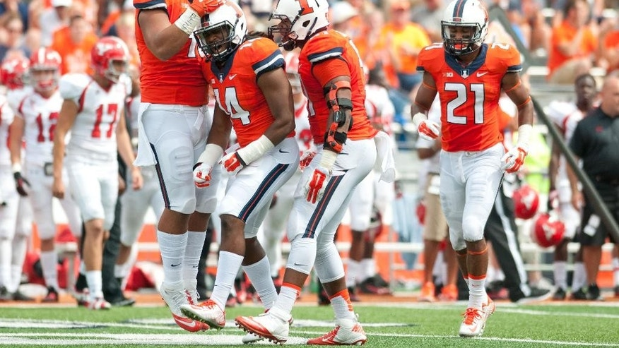 The Illinois defense celebrates a tackle during the fourth quarter of an NCAA college football game against Youngstown State, Saturday, Aug. 30, 2014, at Memorial Stadium in Champaign, Ill. (AP Photo/Bradley Leeb)