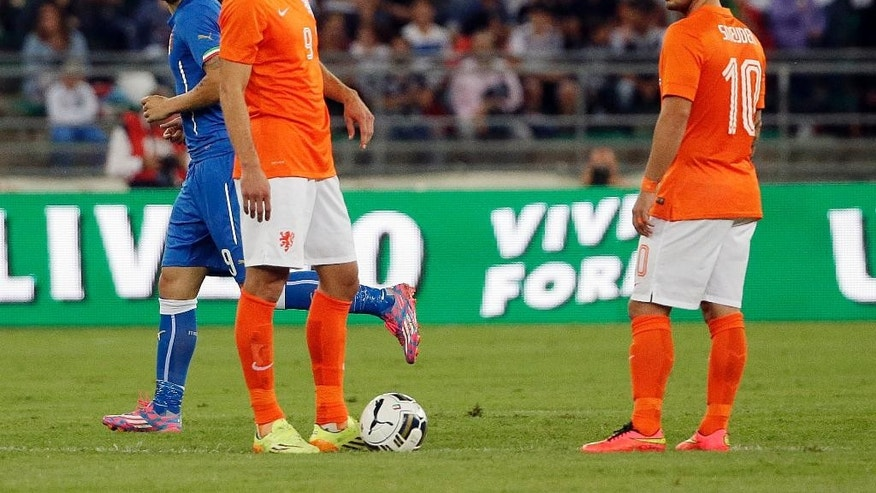 Italy's Ciro Immobile, left, celebrates past Netherlands' Robin van Persie, second from left, and Netherlands'  Wesley Sneijder after he scored during a friendly soccer match between Italy and The Netherlands in Bari, Italy, Thursday, Sept. 4, 2014. (AP Photo/Gregorio Borgia)