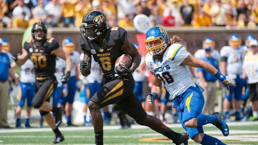 Missouri wide receiver Darius White, left, runs past South Dakota State's Jake Gentile, right, as he scores during the first quarter of an NCAA college football game Saturday, Aug. 30, 2014, in Columbia, Mo. (AP Photo/L.G. Patterson)