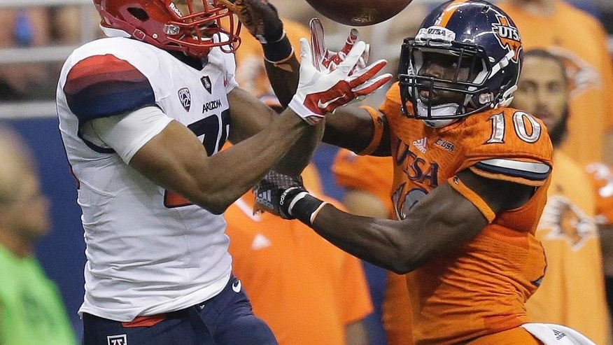 UTSA defender Brian King (10) breaks up a pass intended for Arizona's Austin Hill, left, during the second half of an NCAA college football game, Thursday, Sept. 4, 2014, in San Antonio. (AP Photo/Eric Gay)