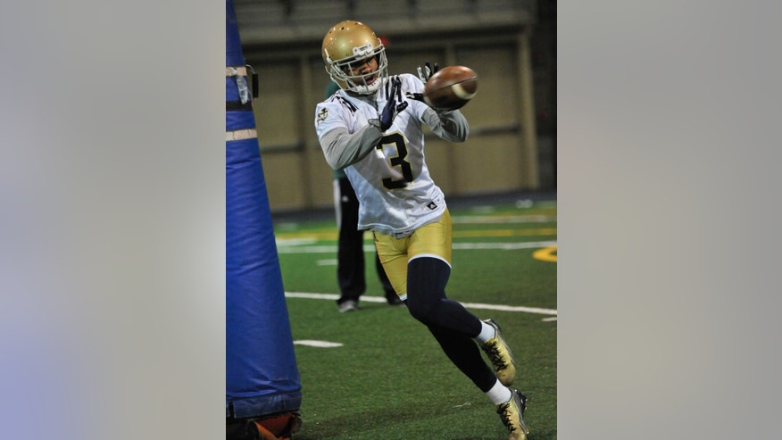 In this photo taken on March 3, 2014, Notre Dame cornerback Cole Luke makes a catch during NCAA college football practice in South Bend, Ind.  (AP Photo/Joe Raymond, File)