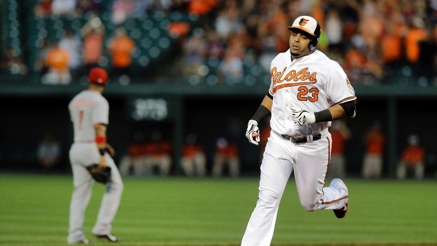 Baltimore Orioles' Nelson Cruz rounds the bases after hitting a two-run home run in the first inning of an interleague baseball game against the Cincinnati Reds, Thursday, Sept. 4, 2014, in Baltimore. (AP Photo/Patrick Semansky)