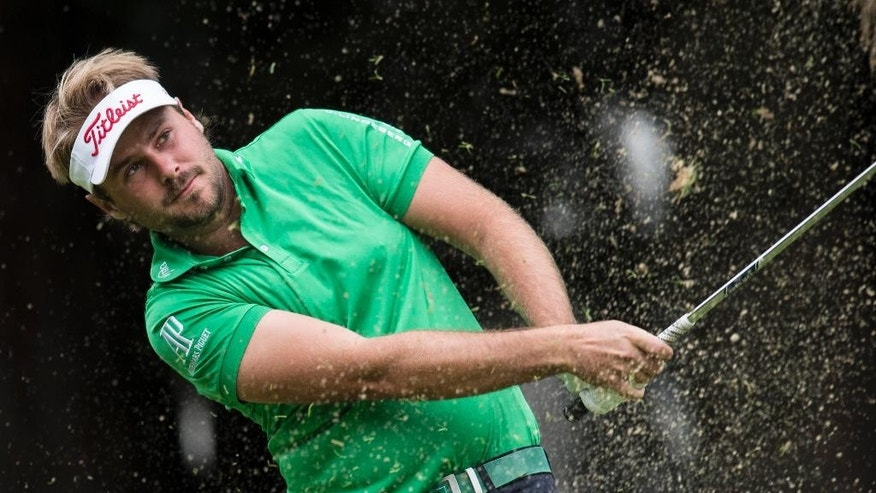 Victor Dubuisson of France plays a ball  at hole 8 during the first round  of the Omega European Masters Golf Tournament in Crans-Montana, Switzerland, Thursday, Sept. 4, 2014. (AP Photo/Keystone,Ennio Leanza)