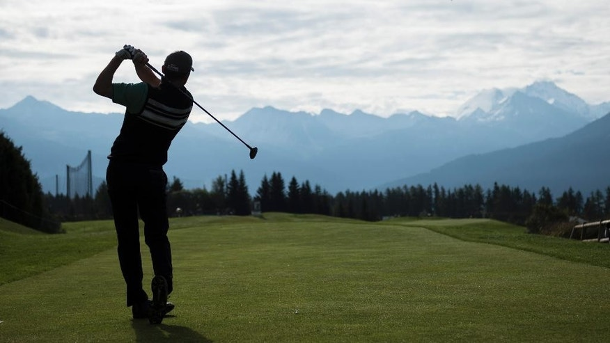 Anders Hansen of Denmark tees off at hole 7 during the first round of the Omega European Masters Golf Tournament in Crans-Montana, Switzerland, Thursday, Sept.  4, 2014.  (AP Photo/Keystone,Ennio Leanza)