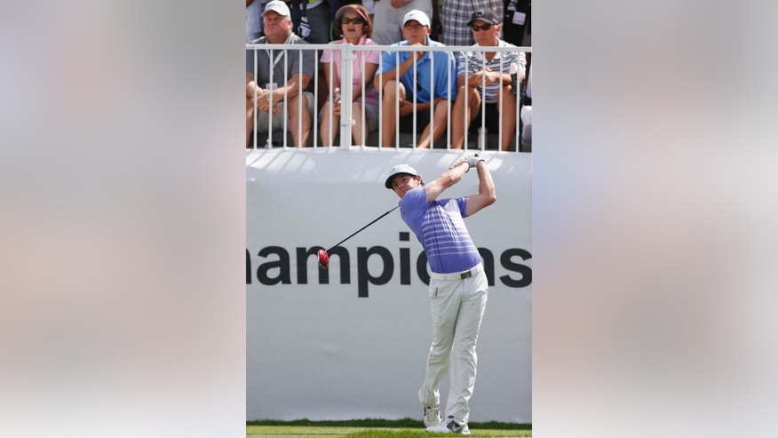 Rory McIlroy, of Northern Ireland, tees off on the 10th hole during the first round of the BMW Championship golf tournament at Cherry Hills Country Club in Cherry Hills Village, Colo., Thursday, Sept. 4, 2014. (AP Photo/Brennan Linsley)