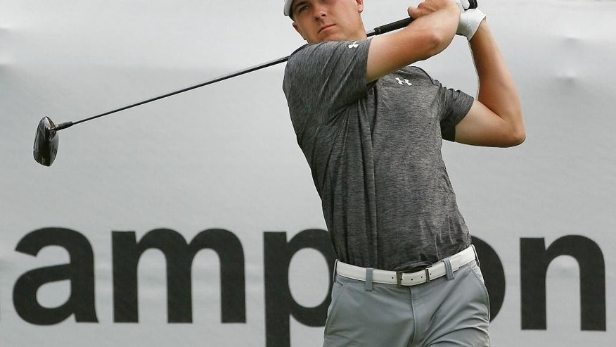 Jordan Spieth tees off on the 10th hole during the first round of the BMW Championship golf tournament at Cherry Hills Country Club in Cherry Hills Village, Colo., Thursday, Sept. 4, 2014. (AP Photo/Brennan Linsley)