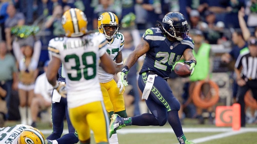 Seattle Seahawks running back Marshawn Lynch (24) scores a touchdown in the first half of an NFL football game against the Green Bay Packers, Thursday, Sept. 4, 2014, in Seattle. (AP Photo/Stephen Brashear)
