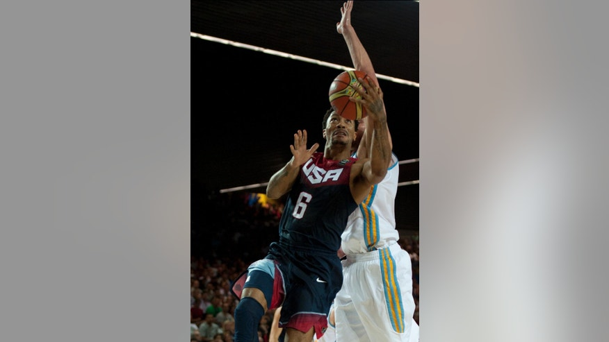 Derrick Rose of the US, left, dunks the ball during the Group C Basketball World Cup match against Ukraine in Bilbao, northern Spain, Thursday Sept. 4, 2014. The 2014 Basketball World Cup competition take place in various cities in Spain from Aug. 30 through to Sept. 14. (AP Photo/Alvaro Barrientos)