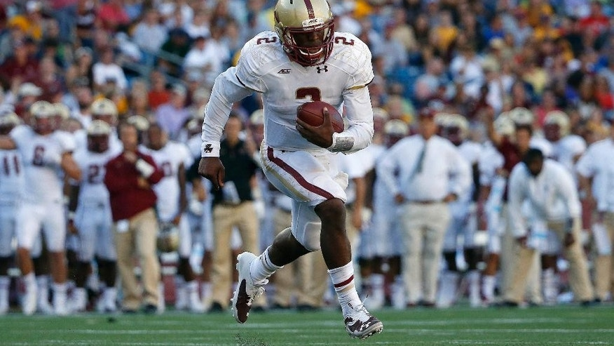 Boston College quarterback Tyler Murphy (2) carries the ball on a touchdown run during the third quarter of an NCAA college football game against Massachusetts in Foxborough, Mass., Saturday, Aug. 30, 2014. Boston College won 30-7. (AP Photo/Michael Dwyer)