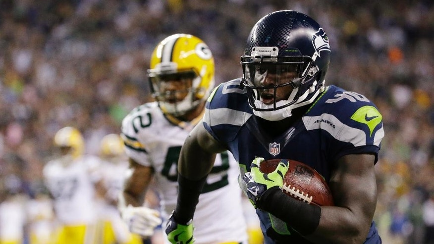 Seattle Seahawks fullback Derrick Coleman, right, runs for a touchdown in the second half of an NFL football game against the Green Bay Packers, Thursday, Sept. 4, 2014, in Seattle. The Seahawks won 36-16. (AP Photo/Elaine Thompson)