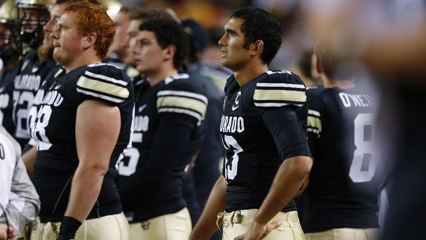 Colorado quarterback Sefo Liufau, right, and teammates wait as time runs out in Colorado State's 31-17 victory over Colorado in an NCAA college football game in Denver on Friday, Aug. 29, 2014. (AP Photo/David Zalubowski)